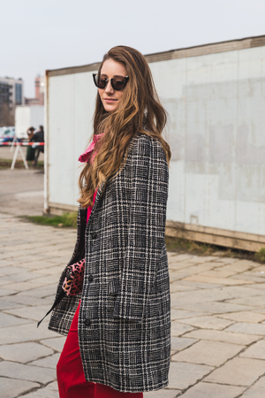 gucci: MILAN, ITALY - FEBRUARY 24: People gather outside Gucci fashion show building for Milan Womens Fashion Week on FEBRUARY 24, 2016 in Milan. Editorial