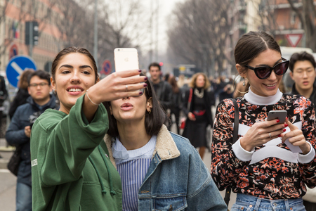 MILAN, ITALY - FEBRUARY 26: People gather outside Emporio Armani fashion show during Milan Womens Fashion Week on FEBRUARY 26, 2016 in Milan. Editorial