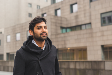 Portrait of a young handsome Indian man posing in an urban context Stock Photo