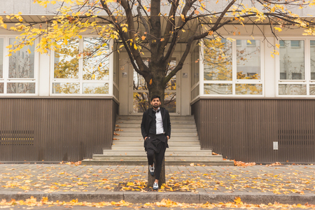 asian style: Portrait of a young handsome Indian man posing in an urban context Stock Photo