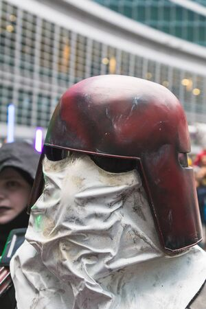 clones: MILAN, ITALY - MARCH 5: People of 501st Legion, official costuming organization, take part in the Star Wars Parade wearing perfectly accurate costumes on MARCH 5, 2016 in Milan.