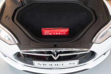 cutting edge: MILAN, ITALY - MARCH 31, 2016: Front trunk of Tesla Model S 90D car. Tesla Motors  is an American company that designs, manufactures, and sells cutting edge electric cars.