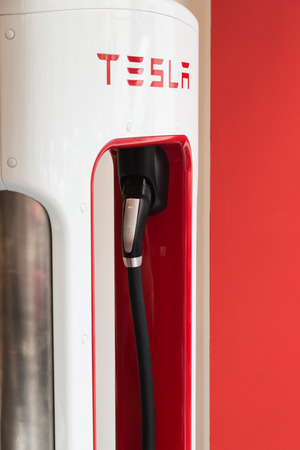supercharger: MILAN, ITALY - MARCH 31, 2016: Detail of Tesla fast-chargeing supercharger station. Tesla Motors  is an American company that designs, manufactures, and sells cutting edge electric cars.