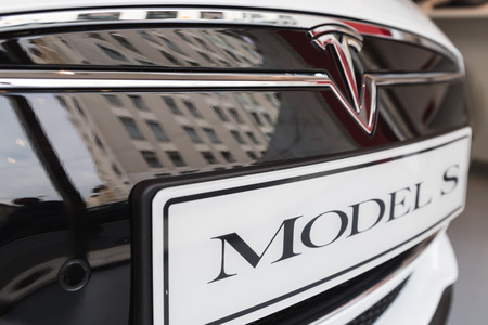 cutting edge: MILAN, ITALY - MARCH 31, 2016: Detail of Tesla Model S 90D car. Tesla Motors  is an American company that designs, manufactures, and sells cutting edge electric cars.