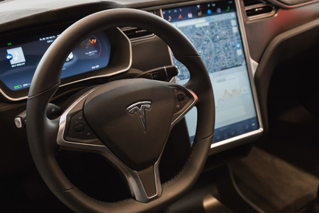 MILAN, ITALY - MARCH 31, 2016: Interior of Tesla Model S 90D car. Tesla Motors  is an American company that designs, manufactures, and sells cutting edge electric cars. Editoriali