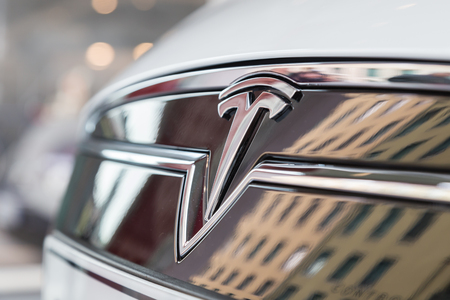 MILAN, ITALY - MARCH 31, 2016: Detail of Tesla Model S 90D car. Tesla Motors  is an American company that designs, manufactures, and sells cutting edge electric cars.