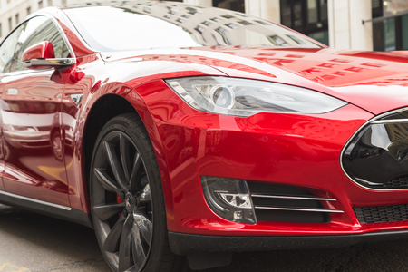 cutting edge: MILAN, ITALY - MARCH 31, 2016: Detail of Tesla Model S P90D car. Tesla Motors  is an American company that designs, manufactures, and sells cutting edge electric cars.