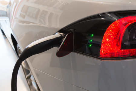 cutting edge: MILAN, ITALY - MARCH 31, 2016: Detail of Tesla Model S 90D car while charging. Tesla Motors  is an American company that designs, manufactures, and sells cutting edge electric cars.