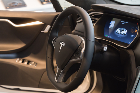 cutting edge: MILAN, ITALY - MARCH 31, 2016: Interior of Tesla Model S 90D car. Tesla Motors  is an American company that designs, manufactures, and sells cutting edge electric cars. Editorial