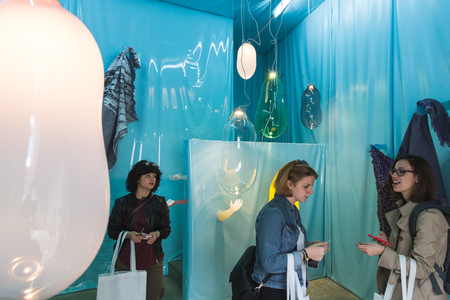 important people: MILAN, ITALY - APRIL 12: People visit Fuorisalone at Ventura Lambrate space, location of important events during Milan Design Week on APRIL 12, 2016 in Milan.