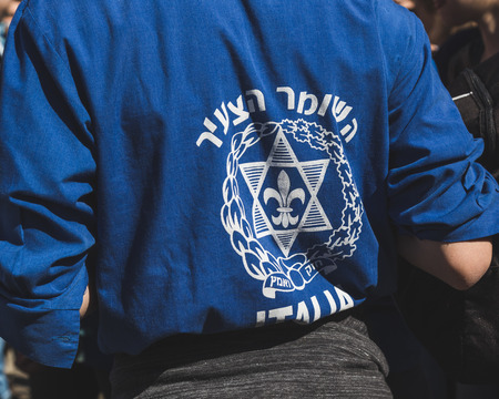 zionist: MILAN, ITALY - APRIL 25: Detail of Hashomer Hatzair symbol at the Liberation Day parade, end of Mussolinis regime and Nazi occupation in 1945 on APRIL 25, 2016 in Milan.