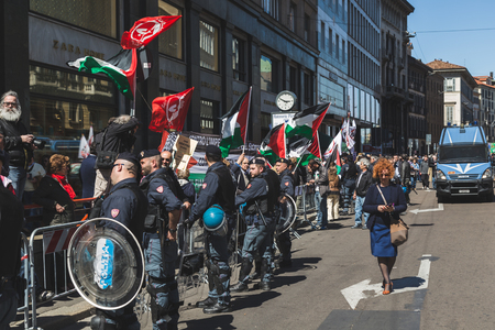 demonstrators: MILAN, ITALY - APRIL 25: Pro-Palestinian demonstrators contest the Jewish Brigade during the Liberation Day parade, end of Mussolinis regime and Nazi occupation in 1945 on APRIL 25, 2016 in Milan. Editorial
