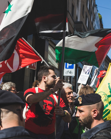 regime: MILAN, ITALY - APRIL 25: Pro-Palestinian demonstrators contest the Jewish Brigade during the Liberation Day parade, end of Mussolinis regime and Nazi occupation in 1945 on APRIL 25, 2016 in Milan. Editorial