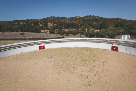 bull rings: IDANHA A VELHA, PORTUGAL - AUGUST 19, 2015: Top view of an empty bullring in one of the oldest Portuguese towns where Romans settled csince the year 16 AD.
