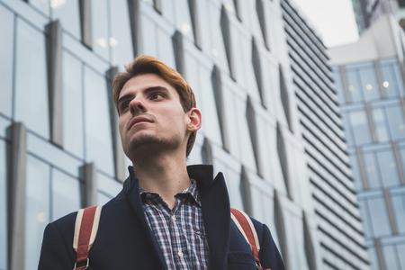 context: Young handsome man posing in an urban context Stock Photo