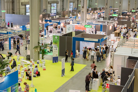 top 7: MILAN, ITALY - JUNE 7, 2016: Top view of people and booths at Technology Hub, international event for innovative and futuristic technologies serving business.