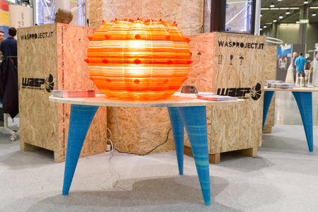printed: MILAN, ITALY - JUNE 7, 2016: 3d printed table and lamp on display at Technology Hub, international event for innovative and futuristic technologies serving business.