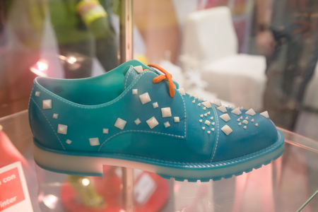 MILAN, ITALY - JUNE 7, 2016: 3d printed shoe on display at Technology Hub, international event for innovative and futuristic technologies serving business.