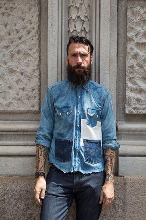 mens fashion: MILAN, ITALY - JUNE 19: Fashionable man poses outside Ferragamo fashion show building during Milan Mens Fashion Week on JUNE 19, 2016 in Milan.