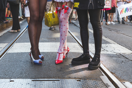 bisexual women: MILAN, ITALY - JUNE 25: Detail of legs and shoes at Pride parade in Milan JUNE 25, 2016. Thousands of people march in the city streets for the annual Pride parade, claiming equality and legal rights.