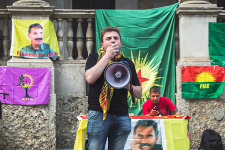 political rally: MILAN, ITALY - JULY 23, 2016: Kurdish activists protest against Turkish president Erdogan and his policy and ask freedom for PKK leader Ocalan.