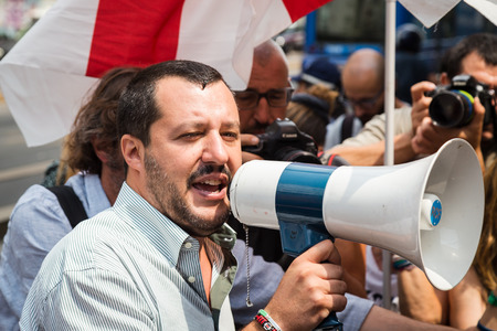 MILAN, ITALY - JULY 22, 2016: The secretary of Lega Nord party Matteo Salvini protests in front of the Turkish consulate against President Erdogan and his policy. Фото со стока - 60043281