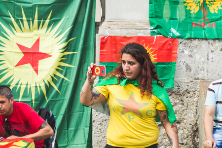 apo: MILAN, ITALY - JULY 23, 2016: Kurdish activist protests against Turkish president Erdogan and his policy and asks freedom for PKK leader Ocalan. Editorial