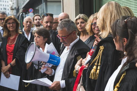 magistrate: MILAN, ITALY - JULY 27, 2016: Italian lawyers demonstrate against president Erdogan in support of their Turkish colleagues.