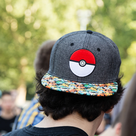 hundreds: MILAN, ITALY - AUGUST 7, 2016: Hundreds of young people meet in a city park and take part in the Pokemon Go Tour, official event for hunting and catching Pokemons.