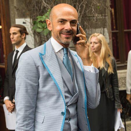 enzo: MILAN, ITALY - SEPTEMBER 21, 2016: Enzo Miccio poses outside Grinko fashion show building during Milan Women Fashion Week SS17.