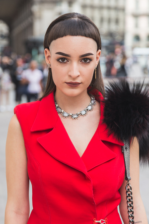 MILAN, ITALY - SEPTEMBER 22, 2016: Fashionable woman poses outside Genny fashion show building during Milan Women Fashion Week SS17. Editorial