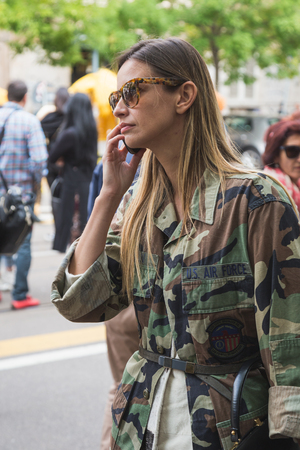 MILAN, ITALY - SEPTEMBER 22, 2016: Fashionable woman poses outside Fendi fashion show building during Milan Women Fashion Week SS17. Editorial