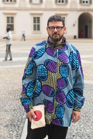 MILAN, ITALY - SEPTEMBER 23, 2016: Fashionable man poses outside Uma Wang fashion show building during Milan Women Fashion Week SS17. Editorial