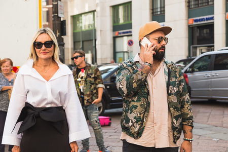 peculiar: MILAN, ITALY - SEPTEMBER 25, 2016: Fashionable people gather outside Ferragamo fashion show building during Milan Women Fashion Week SS17.