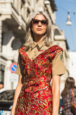 MILAN, ITALY - SEPTEMBER 25, 2016: Fashionable woman poses outside Ferragamo fashion show building during Milan Women Fashion Week SS17.