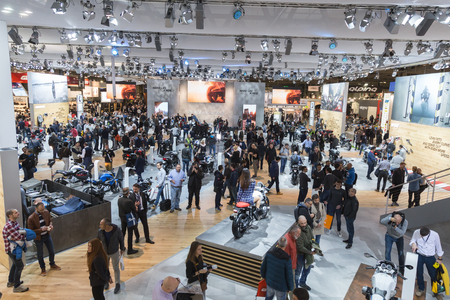 MILAN, ITALY - NOVEMBER 8: People visit EICMA, international motorcycle exhibition on NOVEMBER 8, 2016 in Milan.