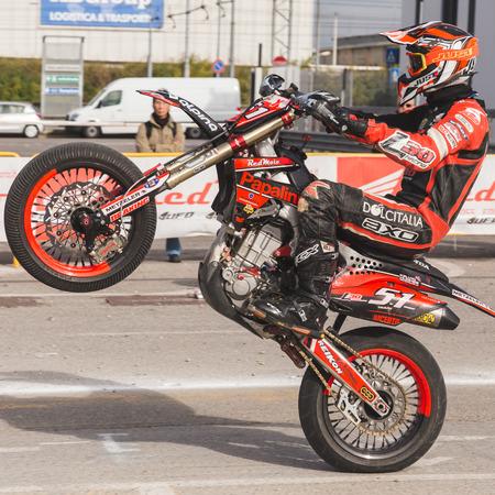 MILAN, ITALY - NOVEMBER 13: Motocross pilots perform  at EICMA, international motorcycle exhibition on NOVEMBER 13, 2016 in Milan.