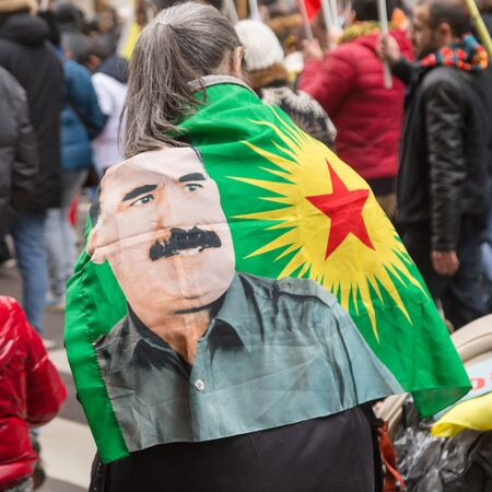 MILAN, ITALY - FEBRUARY 2, 2017: Detail of flag while Kurdish demonstrators protest against the Turkish government and demand the immediate release of their lpolitical leader Ocalan.