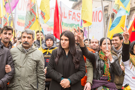 MILAN, ITALY - FEBRUARY 2, 2017: Dilek Ocalan marches with demonstrators protesting against the Turkish government and demanding the immediate release of their lpolitical leader Ocalan.