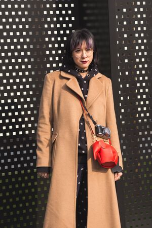 MILAN, ITALY - FEBRUARY 22: Fashionable woman poses outside Gucci fashion show building during Milan Womens Fashion Week on FEBRUARY 22, 2017 in Milan. Editorial