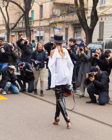 MILAN, ITALY - FEBRUARY 23: Fashionable woman poses outside Fendi fashion show during Milan Women's Fashion Week on FEBRUARY 23, 2017 in Milan.