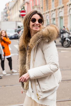 MILAN, ITALY - FEBRUARY 23: Fashionable woman poses outside Fendi fashion show during Milan Womens Fashion Week on FEBRUARY 23, 2017 in Milan.