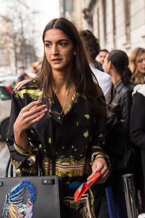 MILAN, ITALY - FEBRUARY 24: Fashionable woman poses outside Etro fashion show during Milan Womens Fashion Week on FEBRUARY 24, 2017 in Milan. Editorial