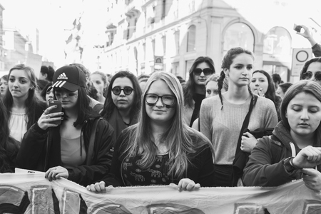 demonstrators: MILAN, ITALY - MARCH 8: Secondary school students take part in a march to celebrate the International Womes Day on MARCH 8, 2017 in Milan.