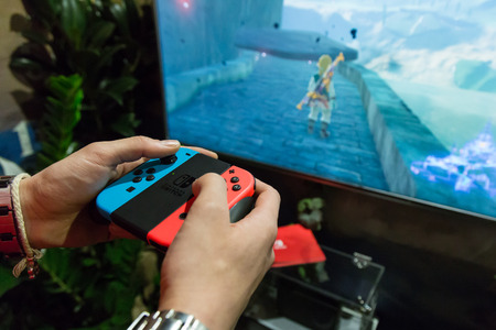 MILAN, ITALY - APRIL 7: The new Nintendo Switch on display at Fuorisalone, set of events distributed in different areas of the town during Milan Design Week on APRIL 7, 2017 in Milan. Publikacyjne