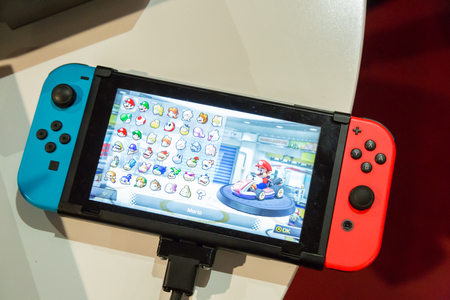 nintendo: MILAN, ITALY - APRIL 7: The new Nintendo Switch on display at Fuorisalone, set of events distributed in different areas of the town during Milan Design Week on APRIL 7, 2017 in Milan. Editorial