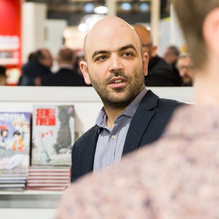 EXHIBIDOR: MILAN, ITALY - APRIL 19: Italian writer Roberto Saviano visits Tempo di Libri, the new Italian Publishing Fair on APRIL 19, 2017 in Milan.