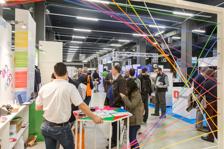 MILAN, ITALY - APRIL 21, 2017: People visit Technology Hub, international event for innovative and futuristic technologies serving business.