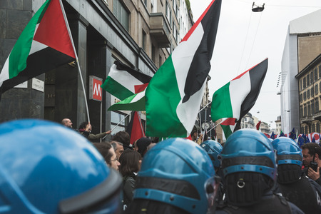 MILAN, ITALY - APRIL 25: Pro-Palestinian demonstrators contest the Jewish Brigade during the Liberation Day parade, end of Mussolinis regime and Nazi occupation in 1945 on APRIL 25, 2017 in Milan. Editorial
