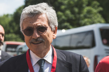 activism: MILAN, ITALY - MAY 20, 2017: Italian politician Massimo DAlema takes part in a peaceful demonstration laying claim to rights and hospitality for immigrants and refugees. Editorial